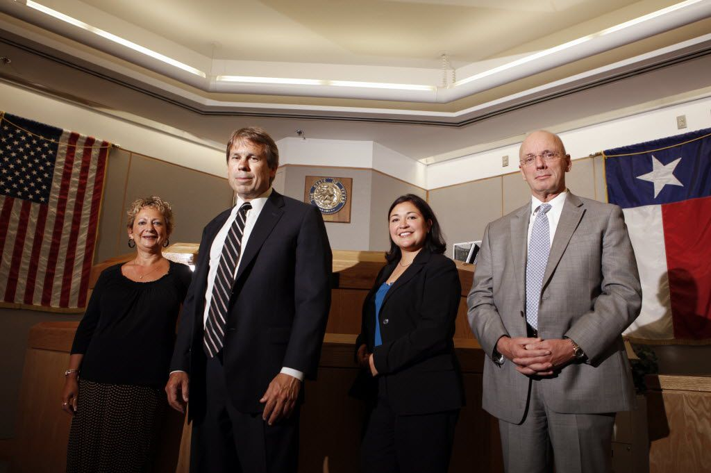 From left to right, members of the first Dallas County conviction integrity unit, paralegal Jena Parker, prosecutor Mike Ware, prosecutor Cynthia R. Garza and investigator James Hammond. After leading Dallas County's first office that investigated inmates' innocence claims, Ware now leads the Innocence Project of Texas.