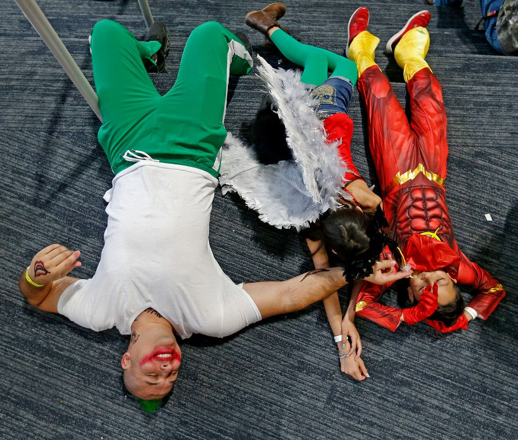 Isaac Planty, dressed as Joker, left, and his son Israel, 9, and daughter Isabelle, 11, take rest during the FAN EXPO Dallas at Kay Bailey Hutchison Convention Center in Dallas, Saturday, April 7, 2018.