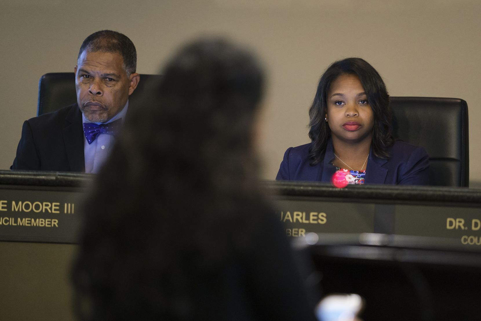 Council member Candice Quarles (right) and Mayor Pro Tem Kenzie Moore III listen to Dorothy Ann Dauenhauer call for transparency during public comment during a meeting of the DeSoto City Council on Tuesday, Aug. 20, 2019, in DeSoto, Texas. (Smiley N. Pool/The Dallas Morning News)