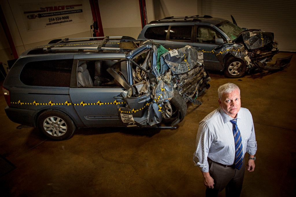 Todd Tracy of Tracy Law Firm stands near crash tested vans at his warehouse in Dallas. (G.J. McCarthy/The Dallas Morning News)