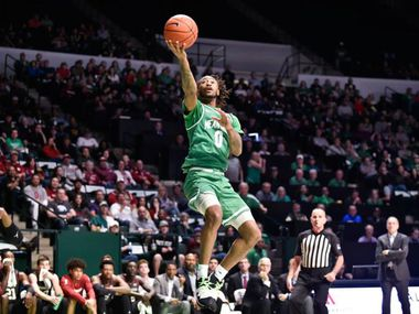 North Texas guard James Reese (0) goes on a fast break and scores in a game at the Super Pit earlier this season. Reese helped UNT tie a program record with 19 makes from 3-point range in a win over Little Rock on Saturday.