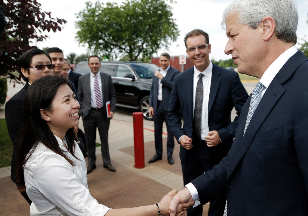 JPMorgan Chase Chairman and CEO Jamie Dimon greets Early College High School student Katia De La Torre at Brookhaven College before announcing a $3 million investment by JPMorgan Chase into Dallas County Promise.