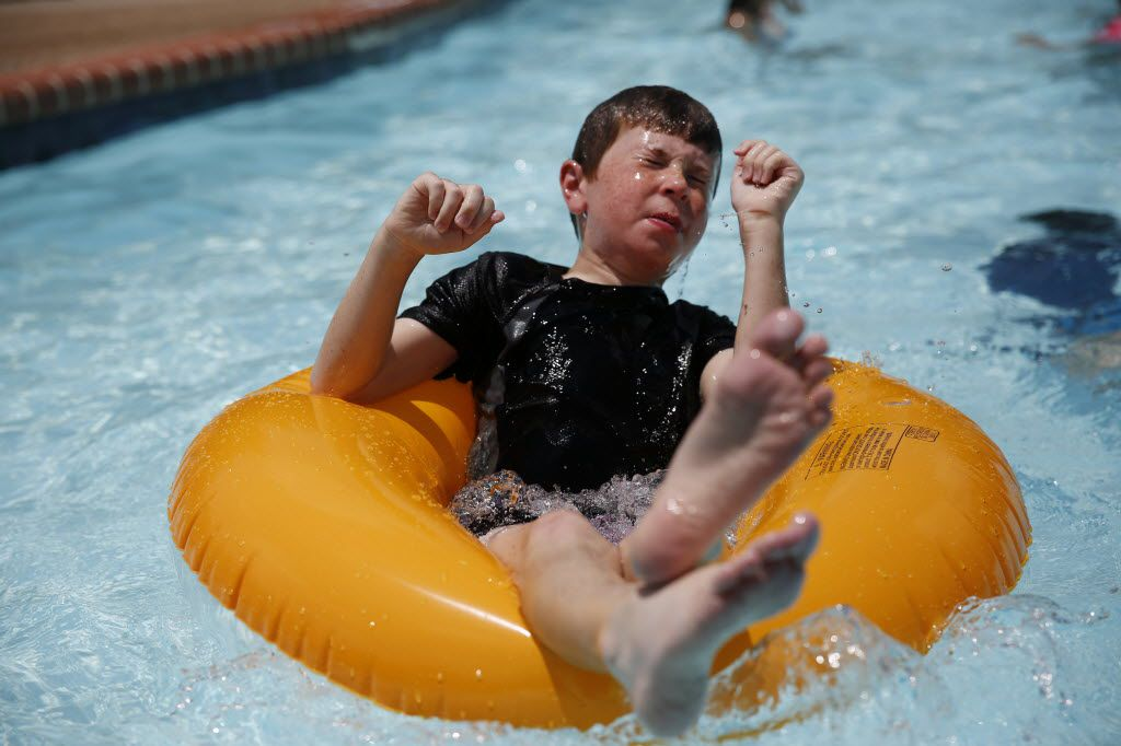 Matthew Olson, 11, of Plano, settles on a tube while swimming during an Independence Day celebration at The Texas Pool on the Creek in Plano on July 4, 2014. The Texas Pool on the Creek, which is shaped like the state of Texas, was established in 1961.