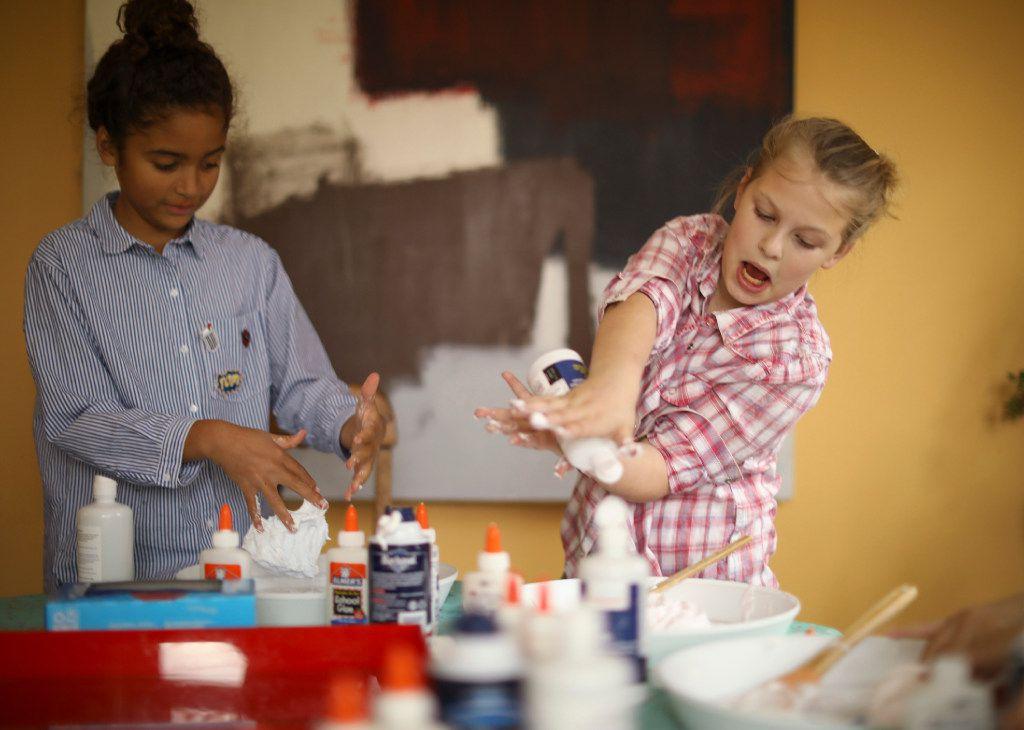 Gigi Shapiro adds more saline solution to her batch of slime while Catherine Walker kneads hers on April 13, 2017, in Edina, Minn. (Jeff Wheeler/Minneapolis Star Tribune)