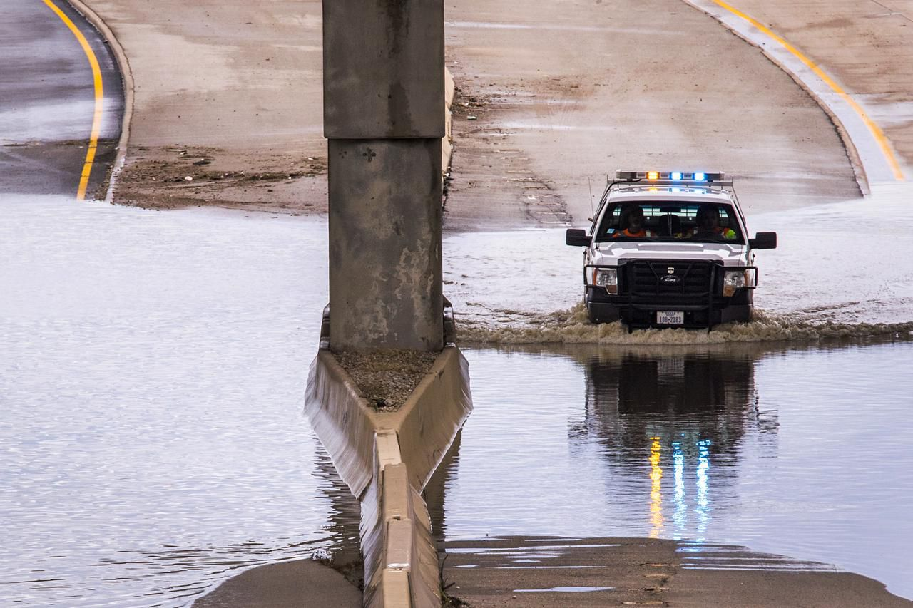 A Texas Department of Transportation vehicle pushed through remaining floodwaters Saturday on the Loop 12 underpass at Interstate 30 in Dallas.