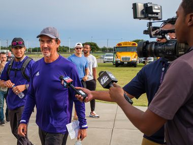 Mount Vernon high school football coach Art Briles talks to reporters after getting off the team bus before his team's season-opening game on Friday, Aug. 30, 2019, in Bonham, Texas. The away game against the Bonham Warriors is the first game at Mount Vernon for Briles, the former Baylor coach. (Smiley N. Pool/The Dallas Morning News)