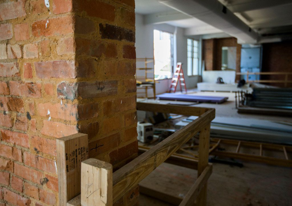 Original brick is shown in a hallway as construction crews work on the old Dallas High School building on Thursday, July 27, 2017 on Bryan Street in downtown Dallas. The 108-year-old building is now an office and retail space.