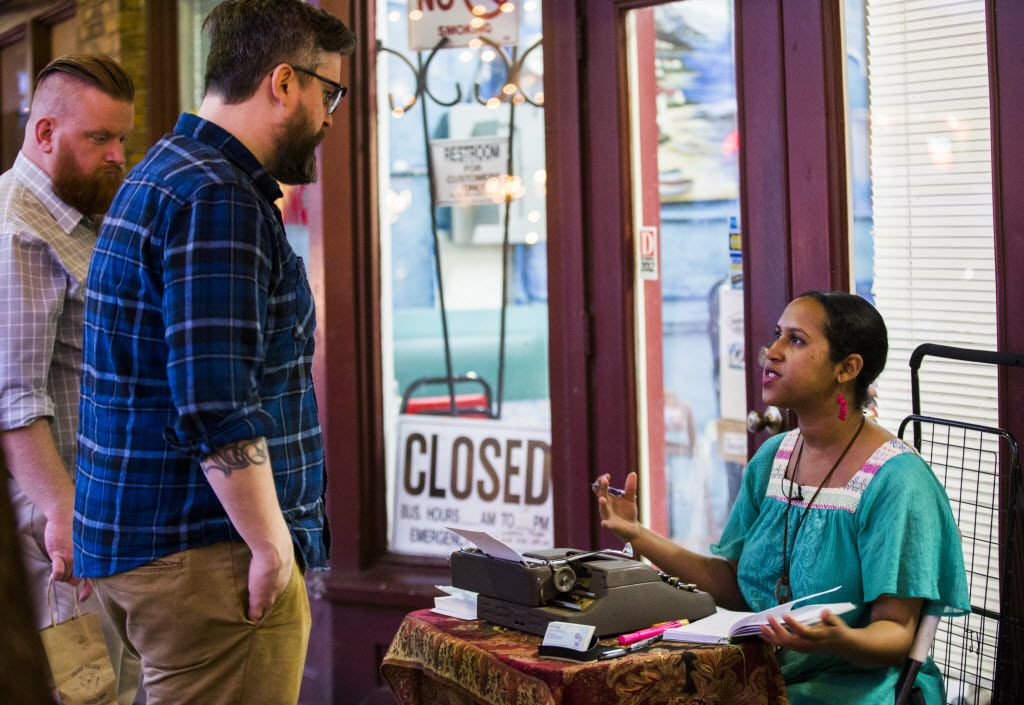 Street poet Fatima Hirsi talks to customer Chris Hart, second from left, on Friday, March 4, 2016 outside El Jordan Cafe on Bishop Ave in Dallas. At left is Patrick McCray.