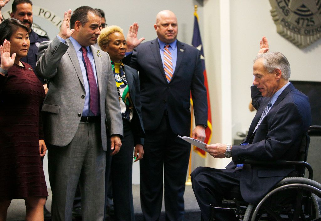 Gov. Greg Abbott swears in new Dallas Police Association board members before announcing grant funding for rifle-proof vests for Texas police officers. (Rose Baca/The Dallas Morning News)