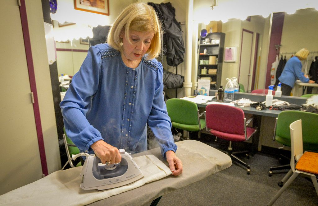 WingSpan's Susan Sargeant irons a pair of pants for an actress before a performance of On the Verge at Bath House Cultural Center.