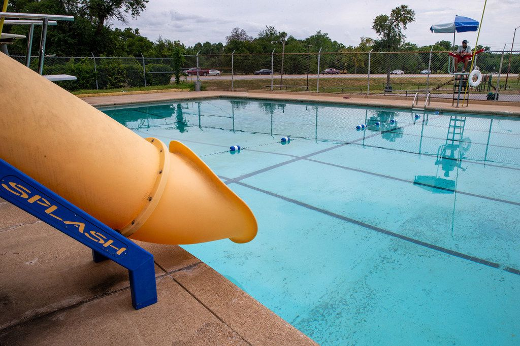Lifeguard Joshua Acosta, 17, looks over the empty Glendale swimming pool in the east Oak Cliff neighborhood of Dallas on July 29.. (Lynda M. Gonzalez/The Dallas Morning News)