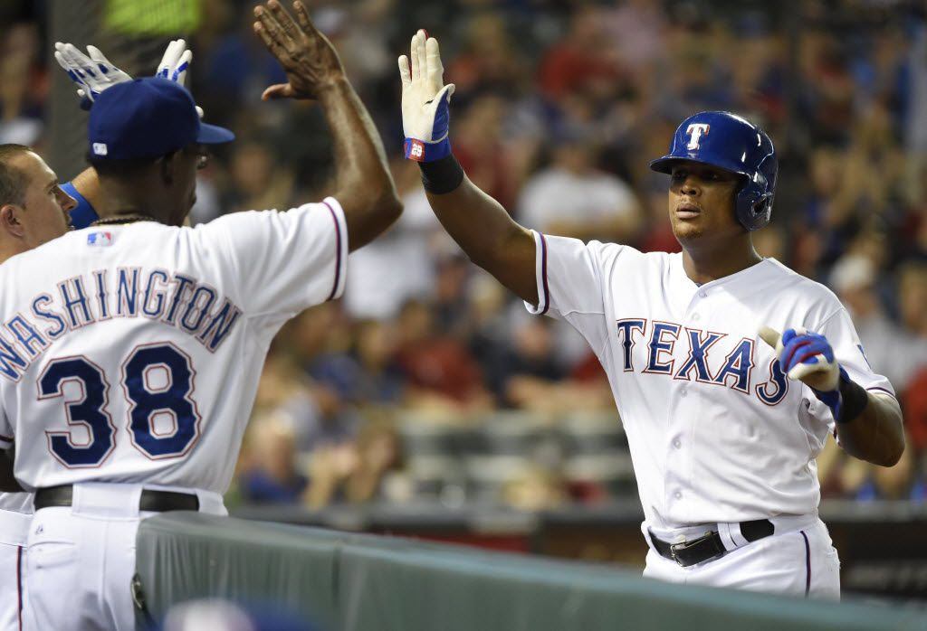 Texas Rangers manager Ron Washington (38) congratulates Texas Rangers third baseman Adrian Beltre (29) after he scored against the Miami Marlins during  the sixth inning of their MLB baseball game at Globe Life Park in Arlington, Texas, on June 10, 2014. (Michael Ainsworth/The Dallas Morning News) 09062014xSPORTS