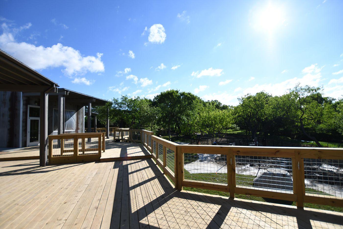 The Shacks restaurants have decks overlooking a greenbelt and creek.