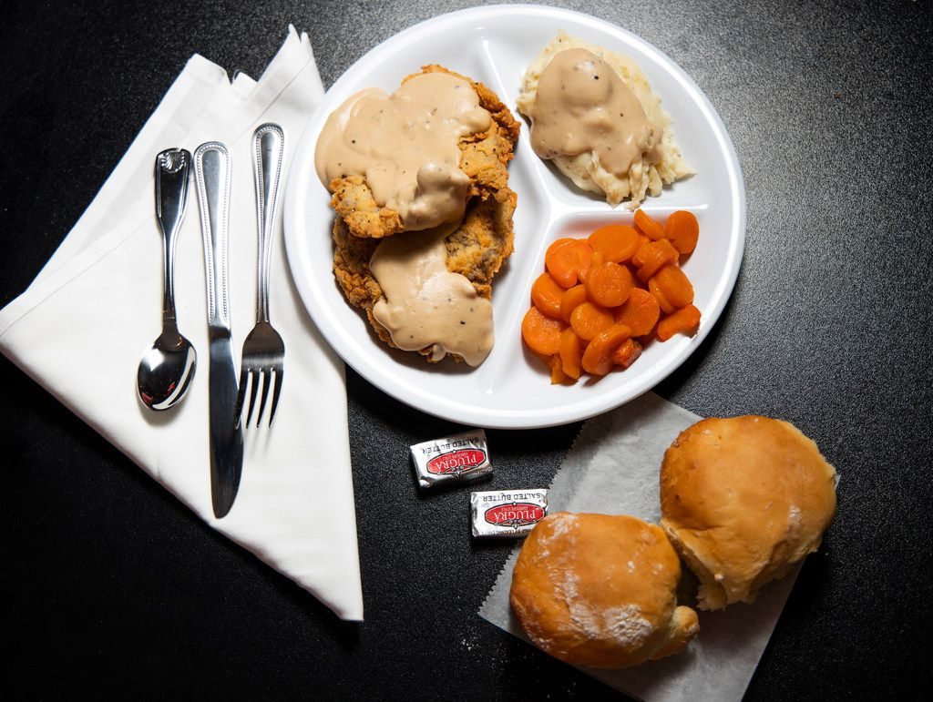 Chicken Fried Steak with with mashed potatoes and gravy, and carrots from Bubba's Cooks Country in Frisco, Texas on Tuesday, Feb. 5, 2019. (Shaban Athuman/The Dallas Morning News)