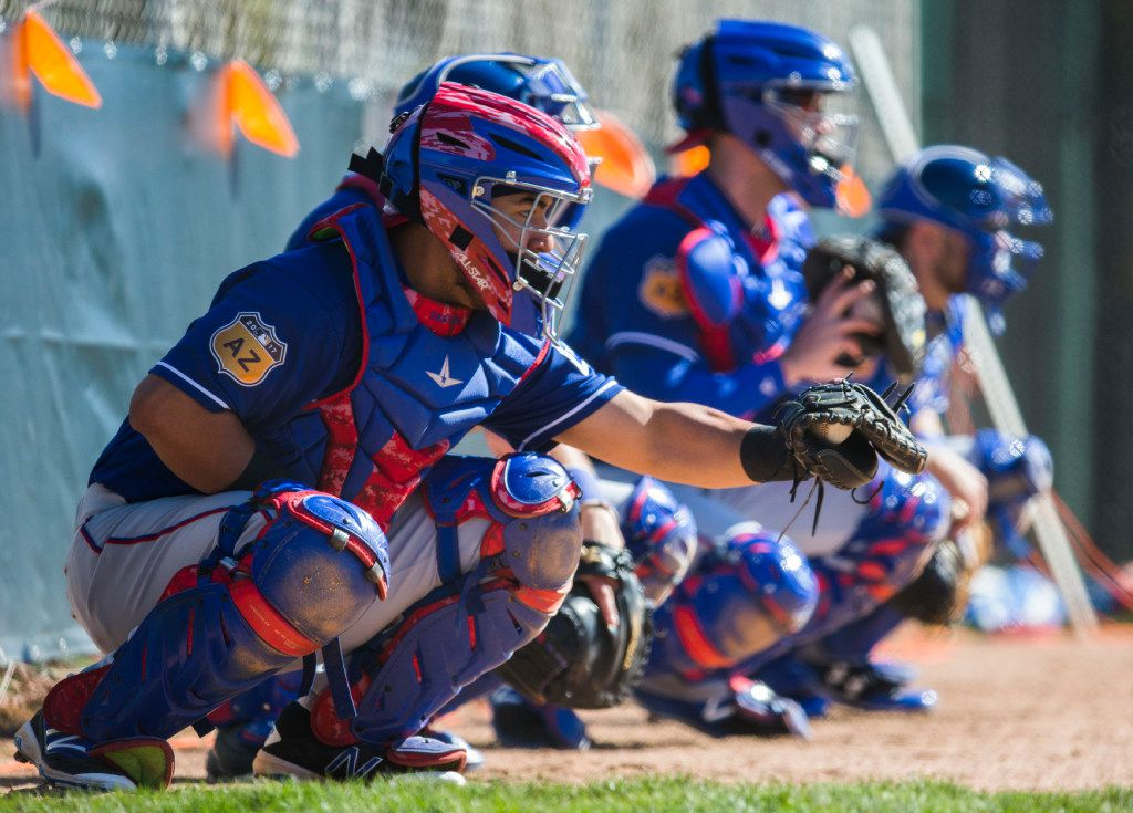 Texas Rangers catchers line up in the bullpen during a spring training workout at the team's training facility on Thursday, February 23, 2017 in Surprise, Arizona. (Ashley Landis/The Dallas Morning News)