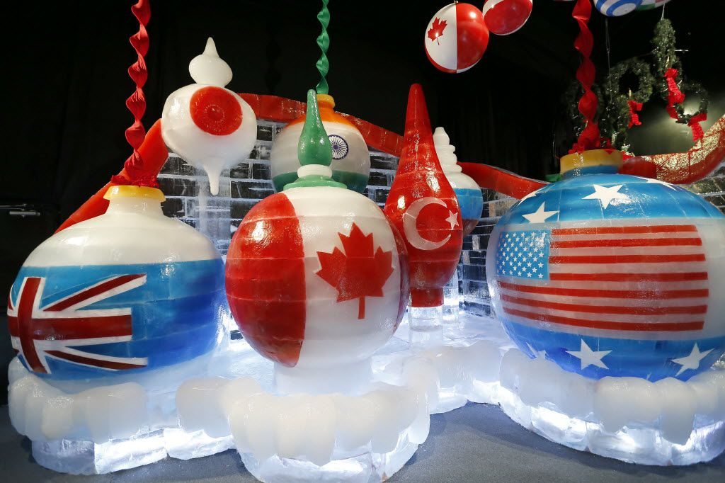 Carved ornaments featuring flags from around the world.