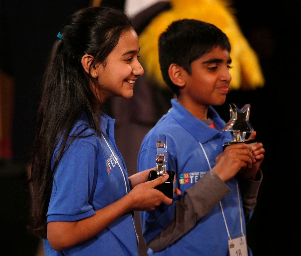 Naysa Modi (left) and Abhijay Kodali were named co-champions of Saturday's the 60th annual Golden Chick Dallas Regional Spelling Bee. (Rose Baca/Staff Photographer)