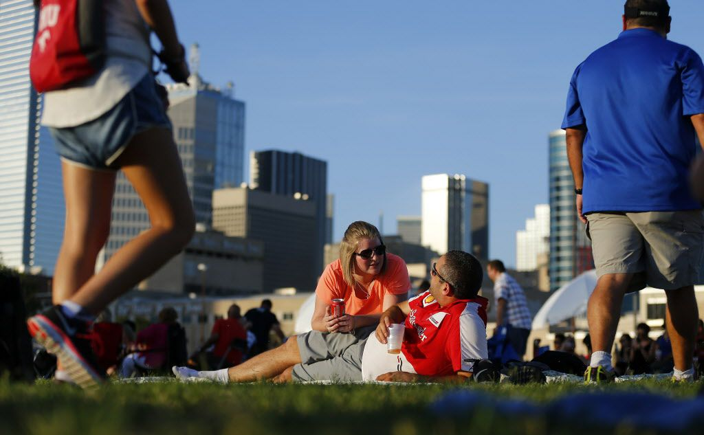 Melissa Redwine and her fiance Chris Wess of Grapevine enjoy the music by Aaron Stephens during the Reunion Lawn Party at the base of Reunion Tower in downtown Dallas, Saturday, July 25, 2015. The event takes place on the last Saturday of each month.  Singer Aaron Stephens and Prophets and Outlaws performed. (Tom Fox/The Dallas Morning News)