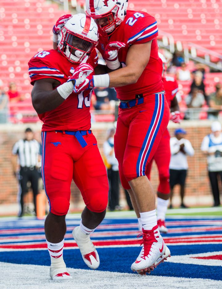 Southern Methodist Mustangs running back Ke'Mon Freeman (13) and Southern Methodist Mustangs tight end Mitchell Kaufman (24) celebrate a touchdown during the fourth quarter of a football game between the University of Connecticut and SMU Texas on Saturday, September 30, 2017 at SMU's Ford Stadium in Dallas. (Ashley Landis/The Dallas Morning News)