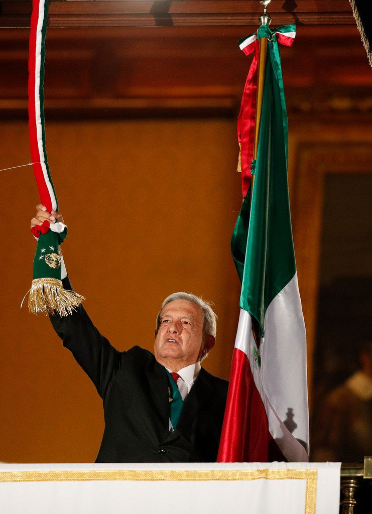 President Andres Manuel Lopez Obrador rings the bell after giving the annual independence shout from the balcony of the National Palace to kick off Independence Day celebrations, at the Zocalo in Mexico City, Sunday, Sept. 15, 2019.