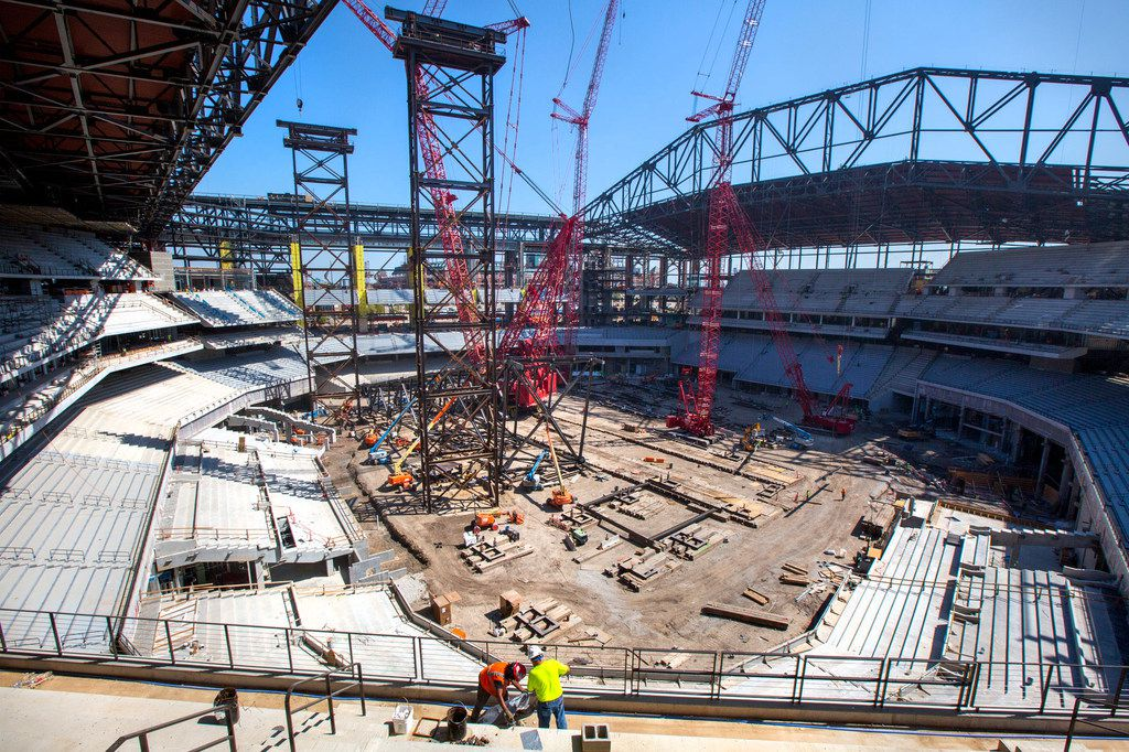 Construction personnel work at the Globe Life Field stadium in Arlington, Texas, on Friday, Aug. 16, 2019. Officials say the project is 70 percent complete.
