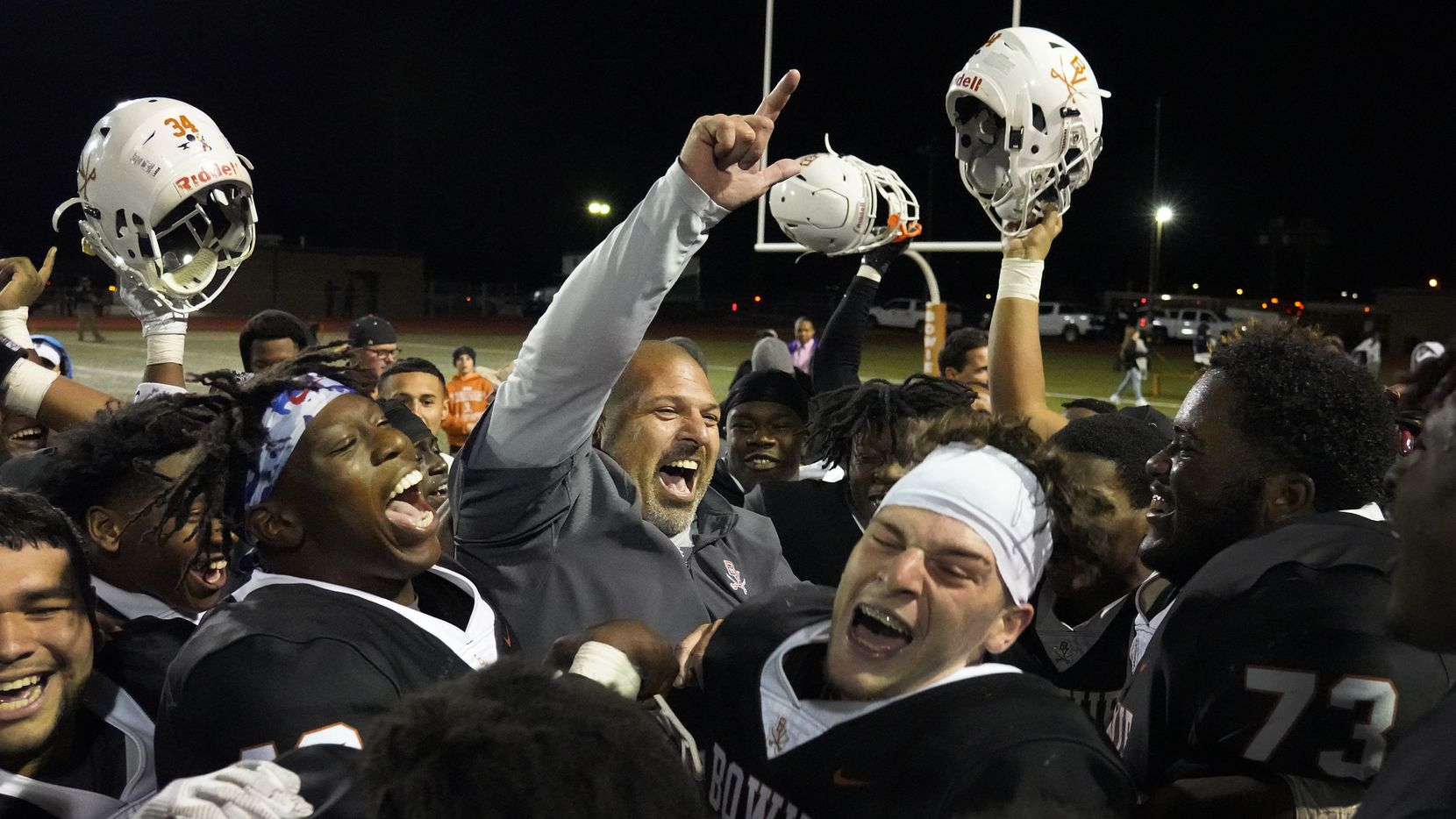 Arlington Bowie head coach Danny DeArman celebrates with his players after a victory over Arlington High School in a high school football game at Wilemon Field on Friday, Oct. 11, 2019, in Arlington, Texas. (Smiley N. Pool/The Dallas Morning News)