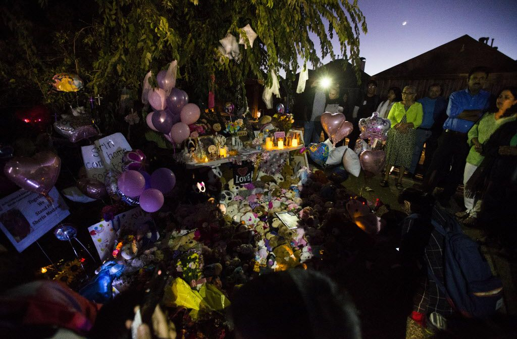 People gather at a memorial for3-year-old Sherin Mathews on Sunday.