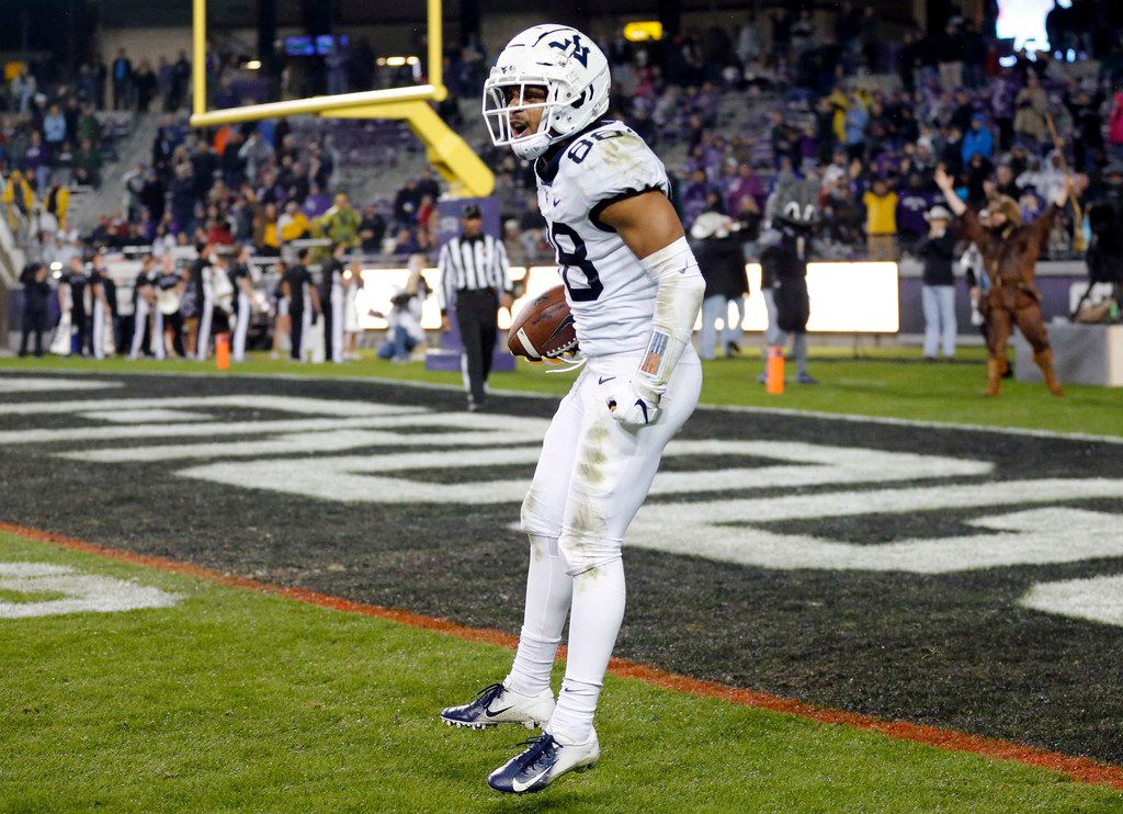 \West Virginia Mountaineers wide receiver Isaiah Esdale (88) celebrates his game-winning touchdown against TCU Horned Frogs cornerback Jeff Gladney (12) in the fourth quarter at Amon G. Carter Stadium in Fort Worth, Friday, November 29, 2019. The Horned Frogs lost, 20-17. (Tom Fox/The Dallas Morning News)