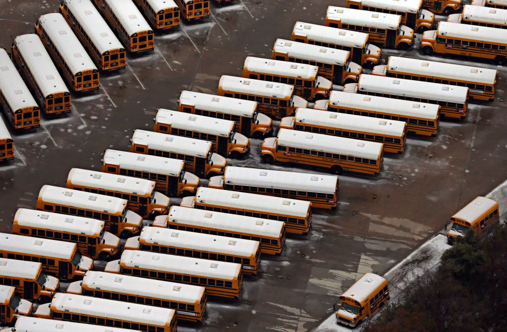 Ice covers the tops of Dallas County Schools buses Saturday, December 6, 2013 in Richardson. Nearly two days after a winter storm blanketed the area with freezing precipitation, ice continued to cause problems for many north Texans. (G.J. McCarthy/The Dallas Morning News)