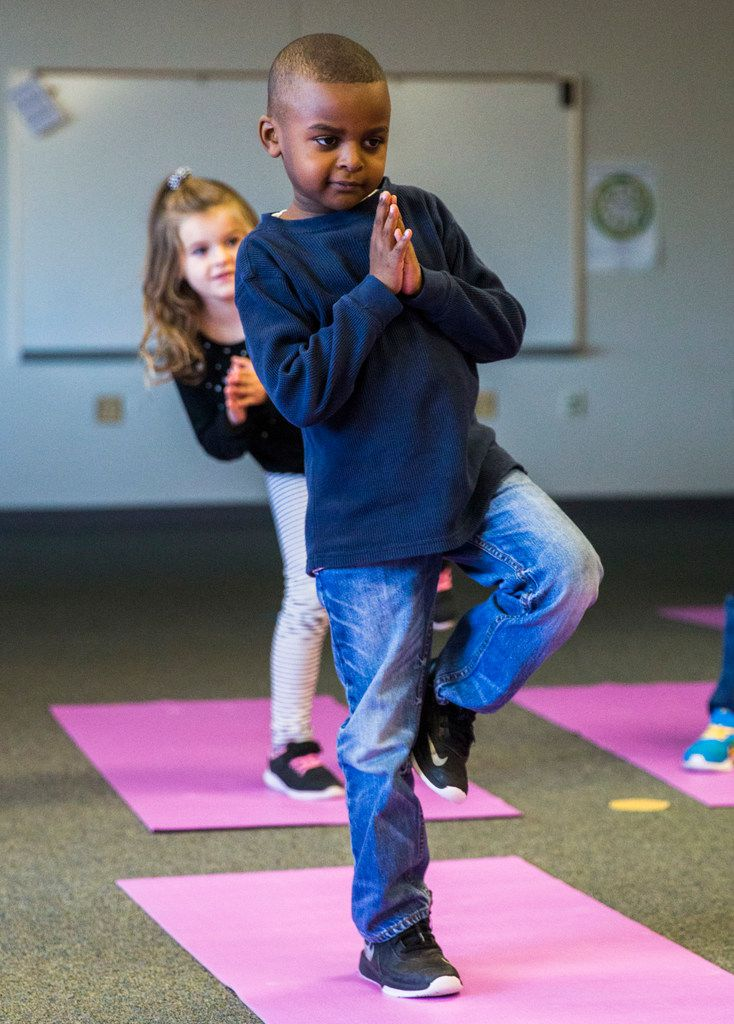Joshua Oatis and other kindergarteners work on balance and other yoga principles during a yoga class at Pink Elementary School in Frisco ISD.