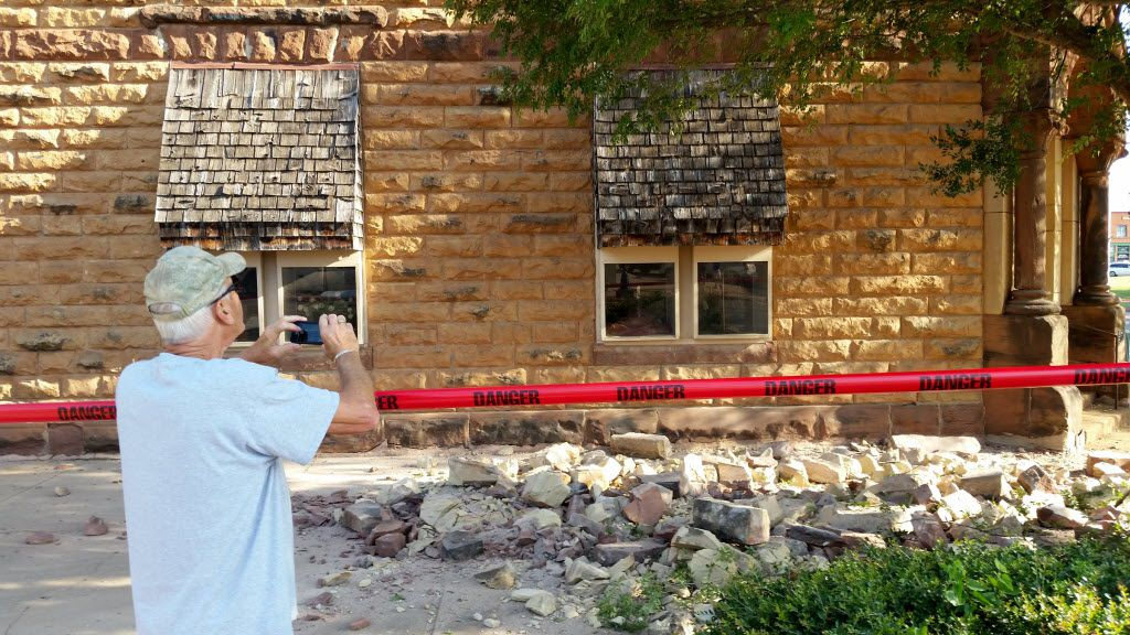 Steve Gibson took photos of a damaged building in downtown Pawnee, Okla., after a 5.8 magnitude earthquake on Sept. 3. The temblor in the edge of the state's key energy-producing areas rattled the Midwest from Nebraska to North Texas. (David Bitton/The News Press)
