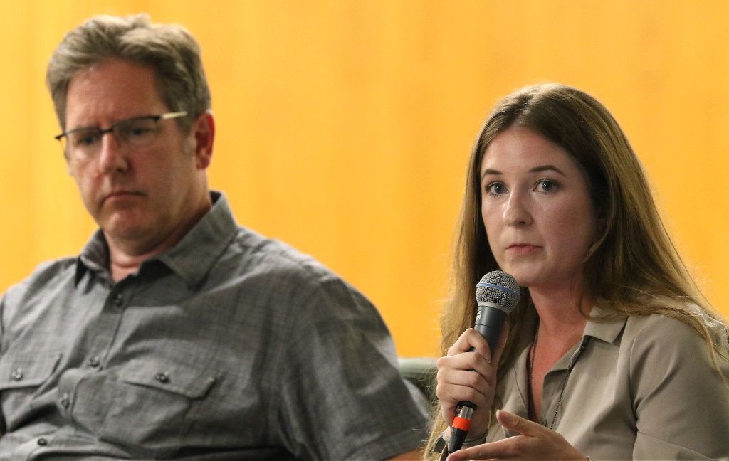 Dallas Morning News photographer Rose Baca, right, talks about an image as Tom Fox listens during a discussion about the July 7th ambush at J. Erik Jonsson Central Library, on Thursday evening, July 6, 2017, in Dallas Texas.