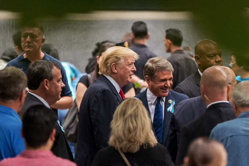 Donald Trump spoke with Rep. Michael McCaul, R-Austin, last month at the ceremony marking the 15th anniversary of the Sept. 11, 2001, terror attack in New York. At left is New Jersey Gov. Chris Christie. (Andrew Harnik/The Associated Press)