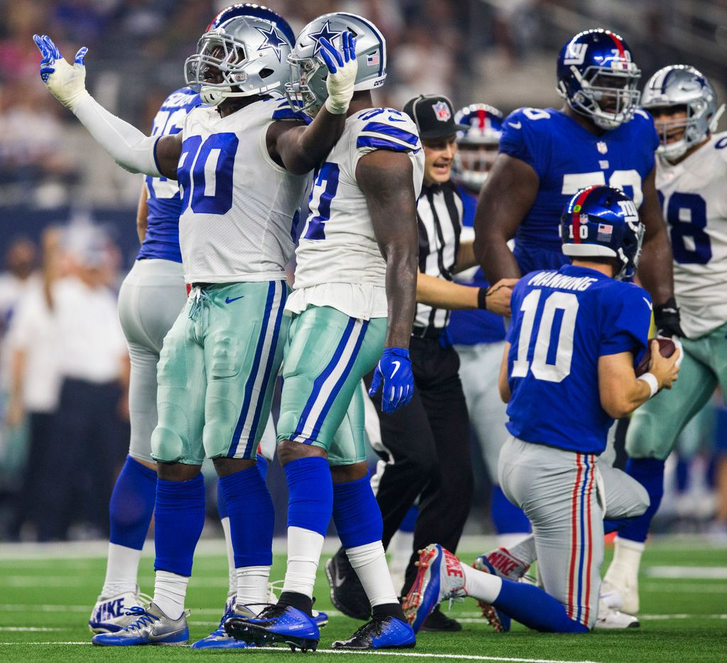 Dallas Cowboys tight end Rico Gathers (80) celebrates sacking New York Giants quarterback Eli Manning (10) during the third quarter of an NFL game between the Dallas Cowboys and the New York Giants on Sunday, September 16, 2018 at AT&T Stadium in Arlington, Texas.