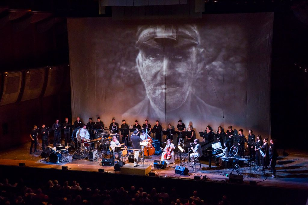 On April 15, Bang on a Can All-Stars and Dallas  Verdigris Ensemble perform DSO composer-in-residence Julia Wolfe's Pulitzer Prize-winning Anthracite Fields, inspired by Pennsylvania coal mining culture and set to a film of archival footage by Jeff Suggs. Shown is New York Philharmonic's 2014 Biennial with Bang on the Can performing Julia Wolfe's Anthracite Fields at Avery Fisher Hall,