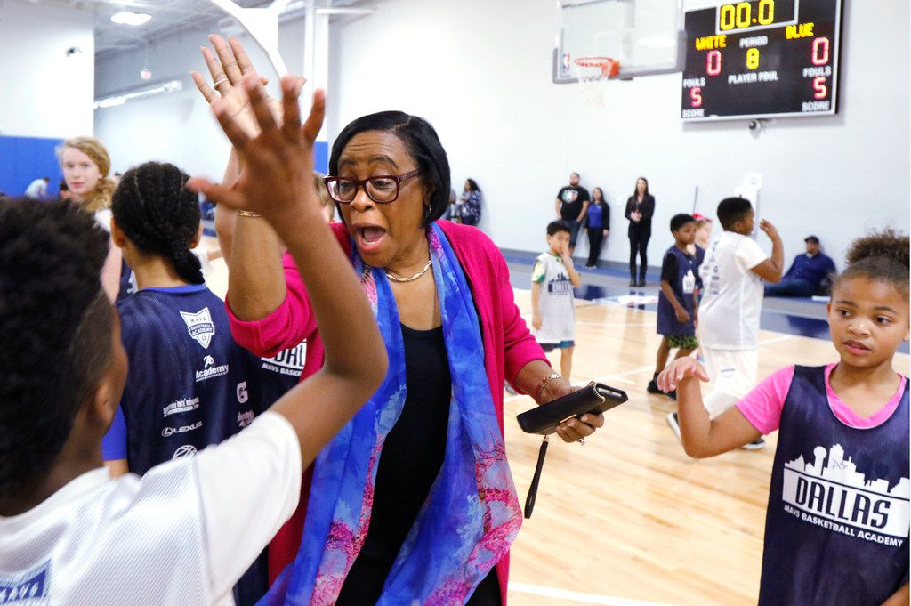 Dallas Mavericks CEO Cynt Marshall high-fived kids at the Mavs Spring Break Hoop Camp in March.