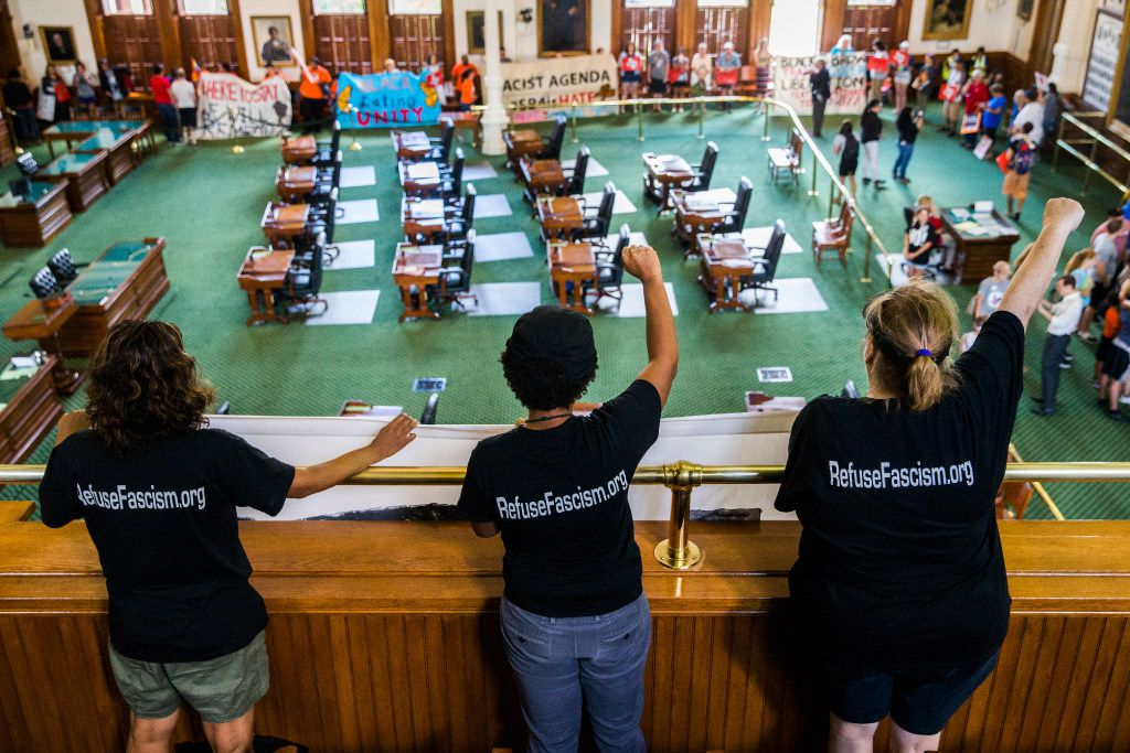 Protesters chant inside the senate chambers as they wait in line to sign the guestbook of Lt. Gov. Dan Patrick during a One Texas Resistance rally on the first day of a legislative special session on Tuesday, July 18, 2017 at the Texas state capitol in Austin, Texas. Demonstrators were told they could not protest outside Patrick's office, so they each signed his guestbook in the hallway.