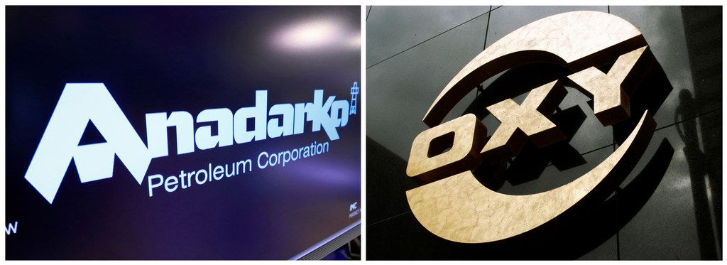 This combo of file photos shows the logo for Anadarko Petroleum Corp. on the floor of the New York Stock Exchange on April 12, 2019, left, and a logo on the Occidental Petroleum building in Los Angeles on  Jan. 26, 2010. A bidding war is breaking out over Anadarko Petroleum, with Occidental making an offer worth $76 per share in cash and stock that it says is about a 20% premium to Chevron's $33 billion deal. (AP Photos)