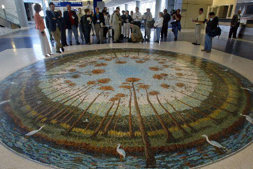 """Local and international journalists got a glimpse at """"Cypress Trees"""" by artist Arthello Beck Jr. during a tour of Terminal D at DFW Airport on April 30, 2005. It was installed after Beck's death in 2004."""