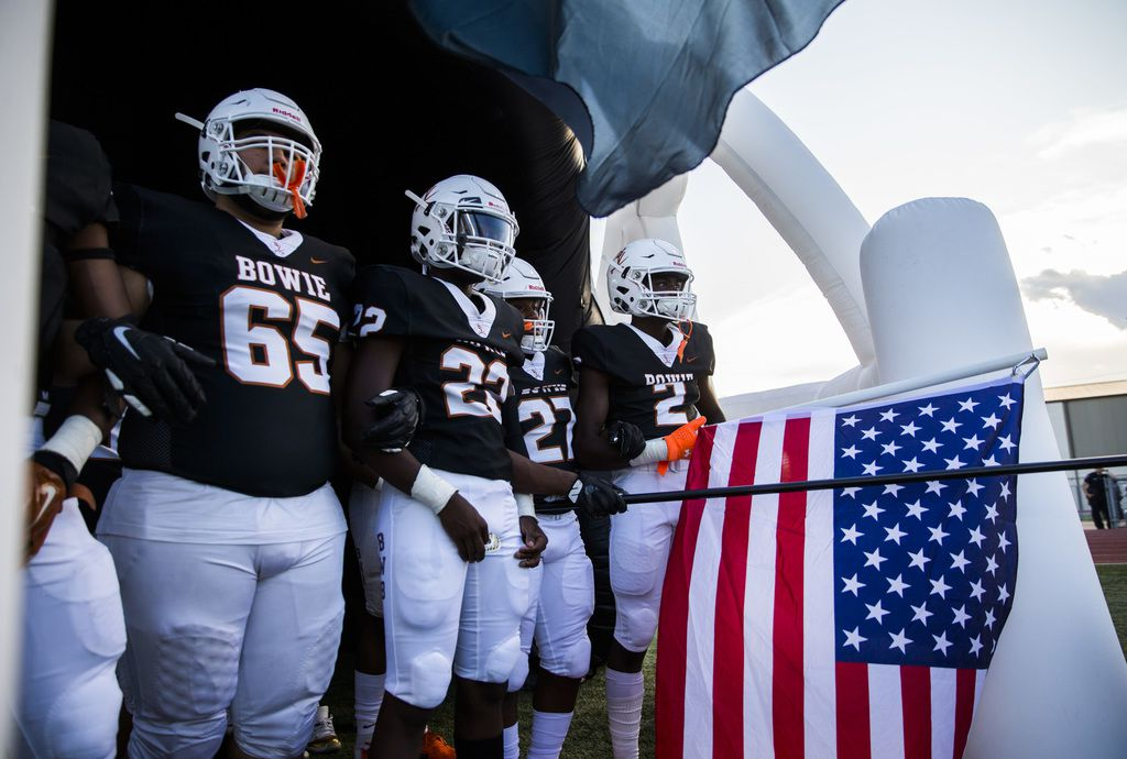 Arlington Bowie football players wait to enter the field before a high school football game between Flower Mound Marcus and Arlington Bowie on Thursday, August 29, 2019 at Wilemon Field in Arlington. (Ashley Landis/The Dallas Morning News)