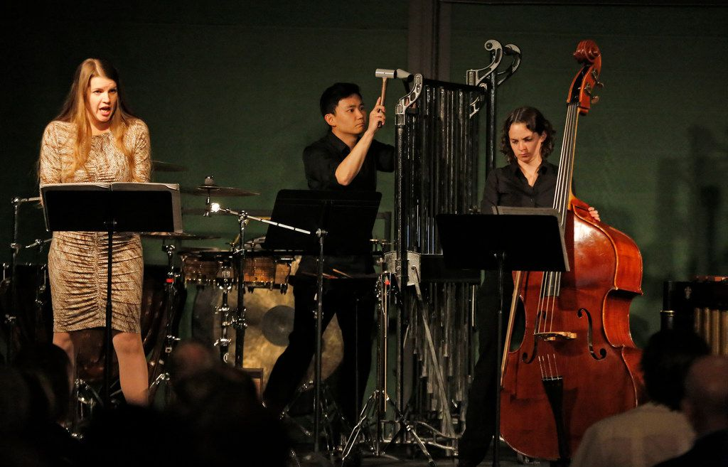 """Vocalist Melanie Henley Heyn, percussionist Sam Seyong Um and double bassist Lizzie Burns perform Sofia Gubaidulina's """"Galgenlieder a 3"""" at a """"Soundings"""" modern music concert at the Nasher Sculpture Center in Dallas on Wednesday, Oct. 24, 2018."""