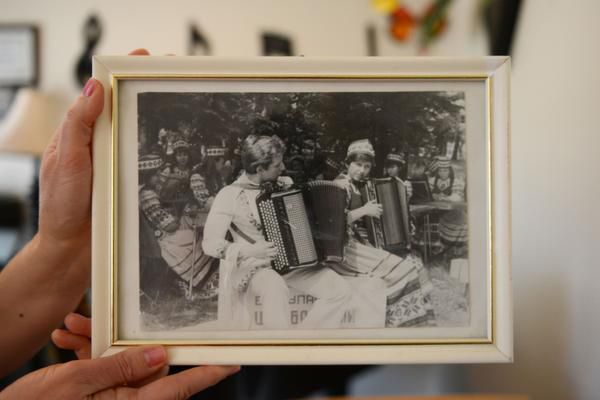 Elena Fainshtein holds a photo of her and her husband, Gregory, playing together in what is now Belarus in 1981.
