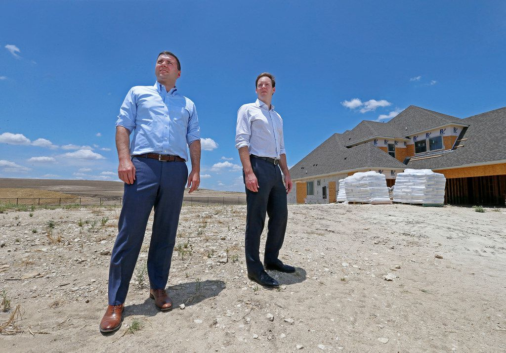 Developers Tony Ruggeri, left, and Jake Wagner, of the Republic Property Group, pose for a photograph on one of lots next to homes that are in construction at the Walsh development in Fort Worth, Texas, Thursday, July 5, 2018. The Walsh development, formerly part of Walsh Ranch, is on more than 7,000 acres. (Jae S. Lee/The Dallas Morning News)