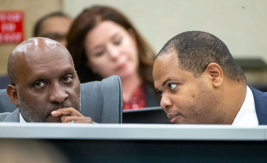 Dallas City Manager T.C. Broadnax (left) listens to Mayor Eric Johnson during a City Council briefing