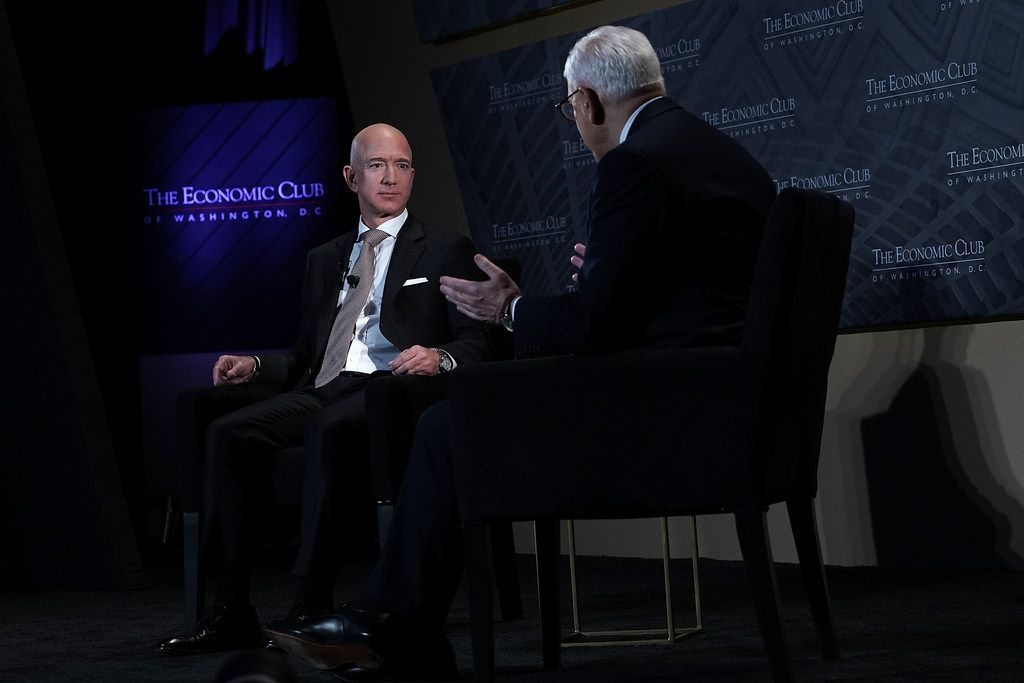 CEO and founder of Amazon Jeff Bezos (left) participates in a discussion with president of the Economic Club of Washington David Rubenstein during a Milestone Celebration dinner Sept. 13, 2018 in Washington, D.C. The club of Washington celebrated its 32nd anniversary at the event.