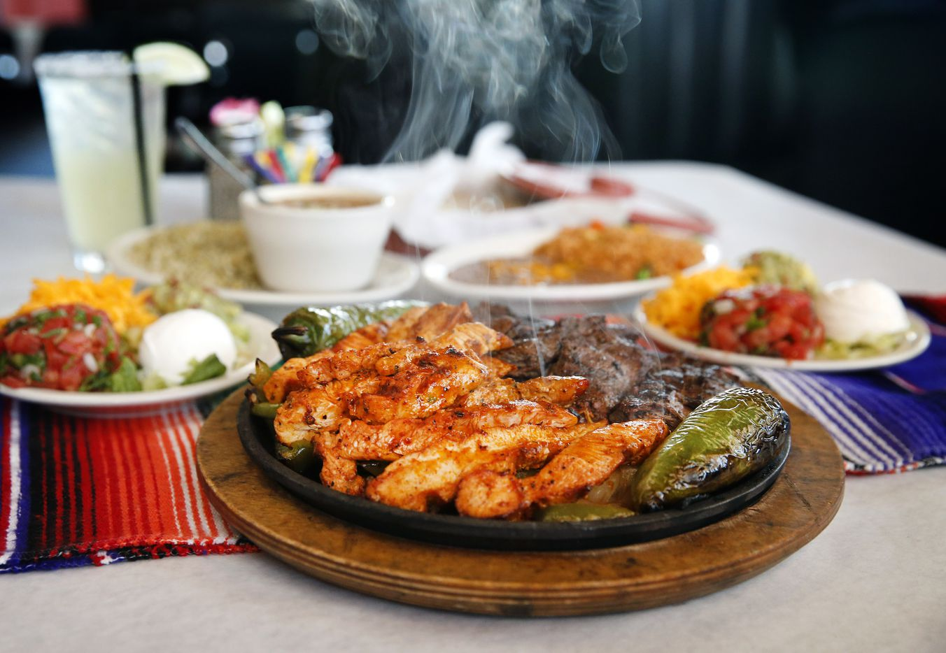 The two-person fajitas plate of chicken and beef with all the fixings is served at El Corazon Vintage Tex-Mex in McKinney, Texas, Thursday, April 25, 2019. They are hosting a four-day fiesta, from May 2 through 5, that doubles as a one-year anniversary party.