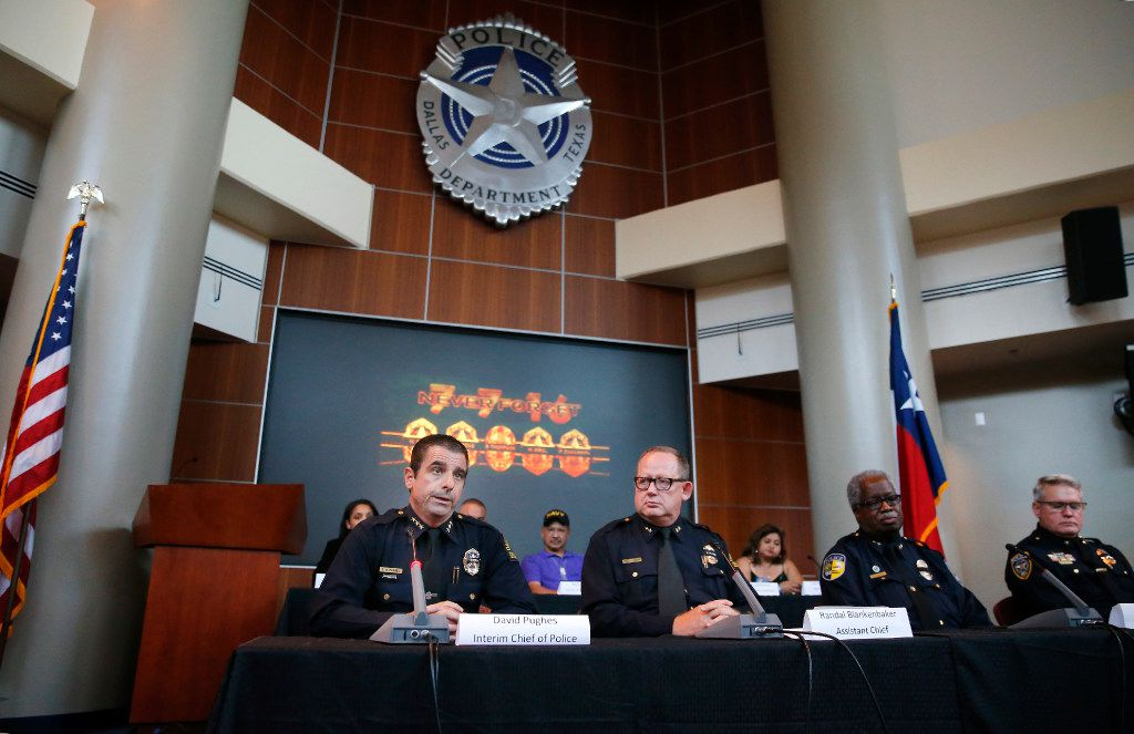 Interim Dallas Police Chief David Pughes (left) speaks alongside Assistant Chief Randal Blankenbaker in a July 7 anniversary panel discussion at police headquarters on Friday, July 7, 2017. DPD and DART police discussed progress they've made since the ambush in downtown Dallas a year ago.