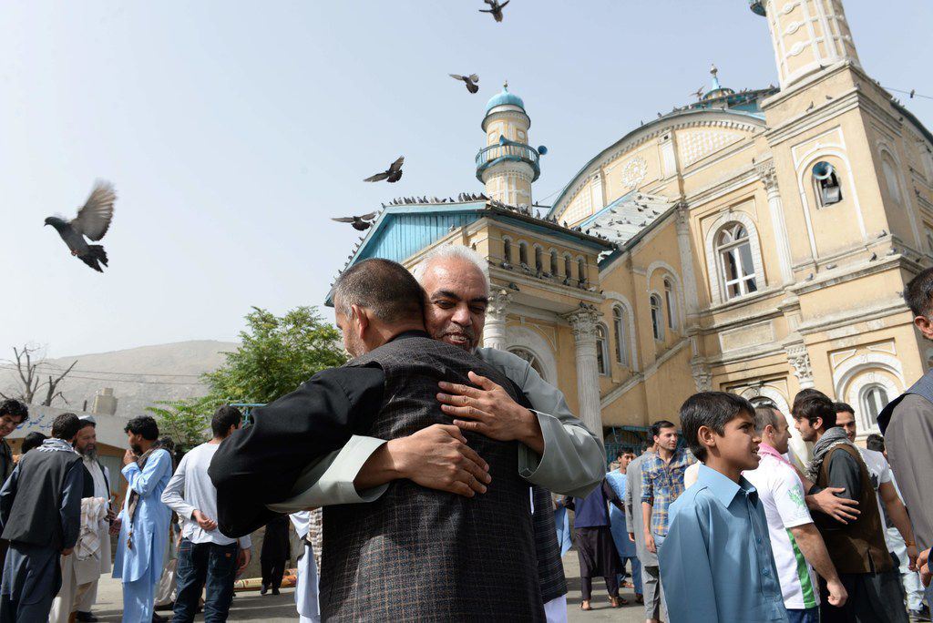 Afghan Muslims hugged each other in June after offering prayers at the start of the Eid al-Fitr holiday marking the end of Ramadan at the Shah-e Do Shamshira mosque in Kabul.