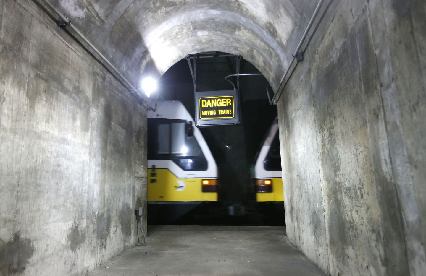 A DART train whizzes past a maintenance tunnel near the unfinished Knox Street station 80 feet below Central Expressway.