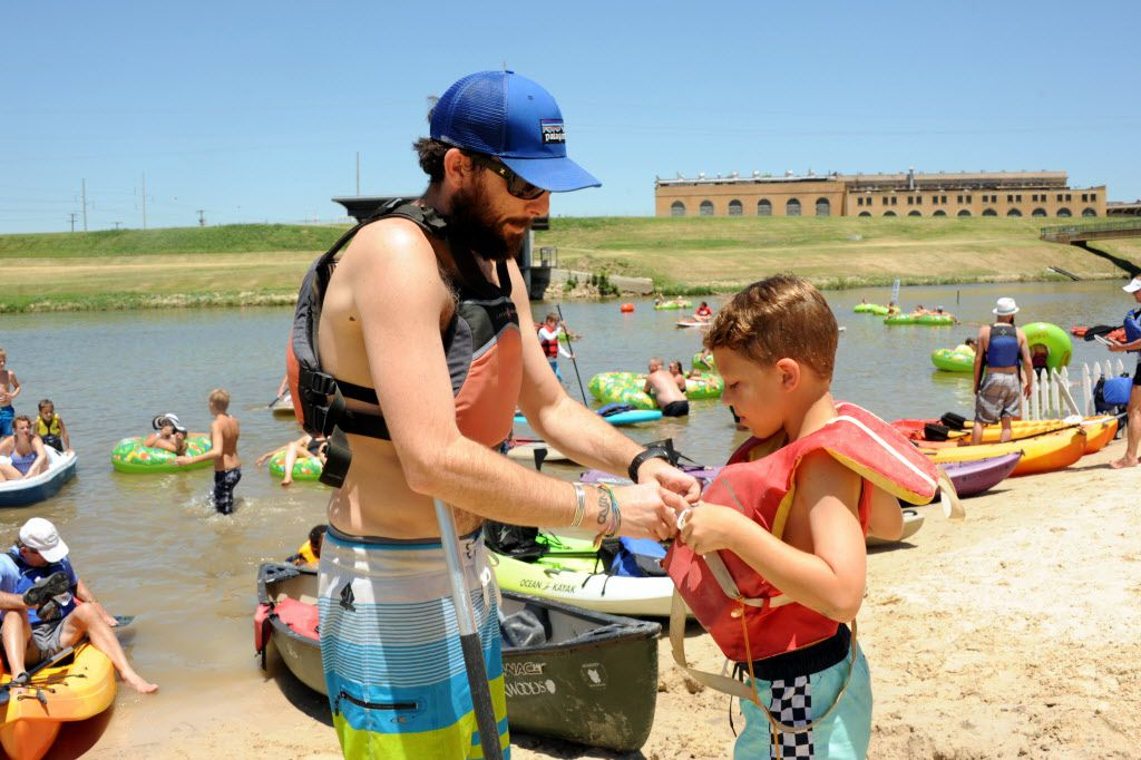 Safety first! Life jackets are secured before swimming in the Trinity River at Sunday Funday.